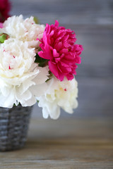 maroon and white peonies in a vase