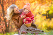 Mother and kid making pinic together in autumn park. - 70824327