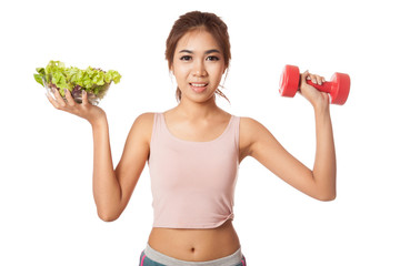 Asian healthy girl with salad bowl and dumbbell