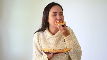 Asian girl show and holding seafood pizza in smile face isolated
