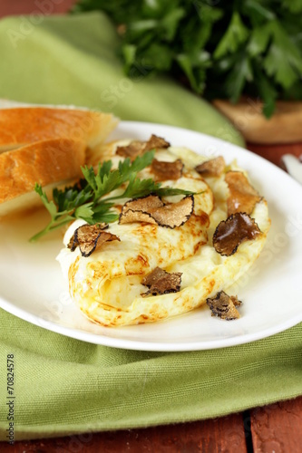 Leinwanddruck Bild gourmet omelette with black truffle and herbs
