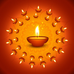 Beautiful colorful religious decoration Diwali diya card celebra