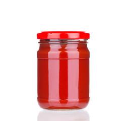 Glass jar full of tomato sauce.
