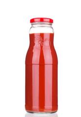 Glass bottle full of tomato juice.