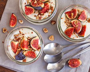 yogurt topped with fresh figs and roasted hazelnuts
