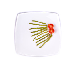 Green marinated asparagus with sliced tomato.
