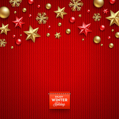 Christmas holidays decorations and label on a knitted background