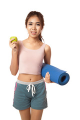 Asian healthy girl with green apple and Yoga Mat