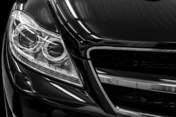 Closeup headlights of business car. Exterior detail.