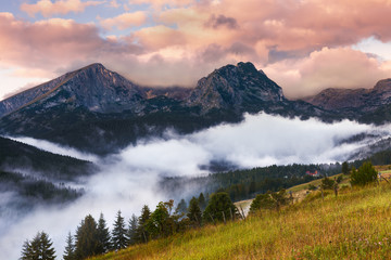 Foggy sunrise with a view of the mountain peaks