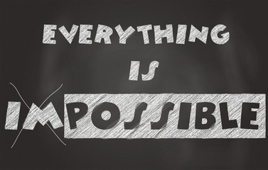 """Everything is possible"" written on a black chalkboard"