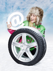 Women presenting onlineshop for winter tyres