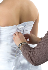 Image of bride's back and bridesmade