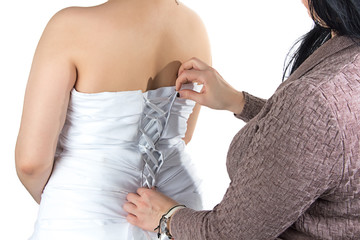 Image of bridesmade and bride's back