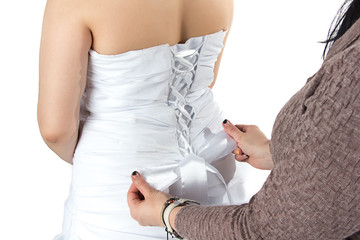 Photo of bridesmade and bride's back