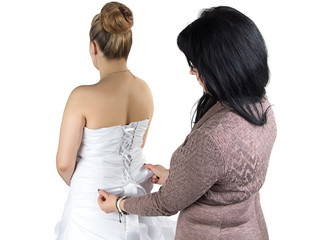 Photo of bridesmade and bride in dress from back