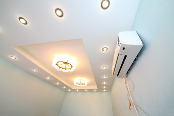 Modern ceiling with a lot of lights and air conditioner