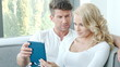 Happy Couple Using Touch Pad
