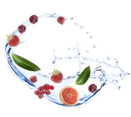 Fresh fruit, berries and green leaves with water splash,