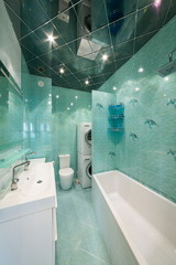 bathroom celadon with bathtub and toilet bowl