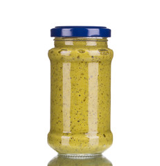 Glass full of italian sauce pesto.