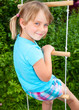 Happy girl on a rope ladder