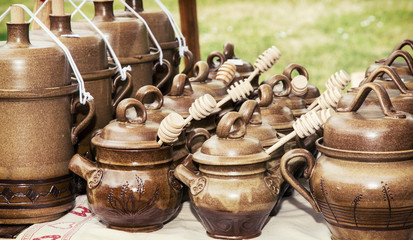 Clay pots with honey dippers