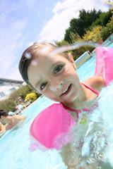 Portrait of cute little girl in swimming pool
