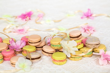 Colorful cookies with cream on table with flowers