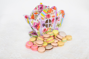 Colorful cookies with cream on table decorated paper teapot