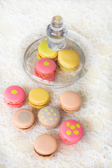 Colorful cookies with cream on table and with little glass cover