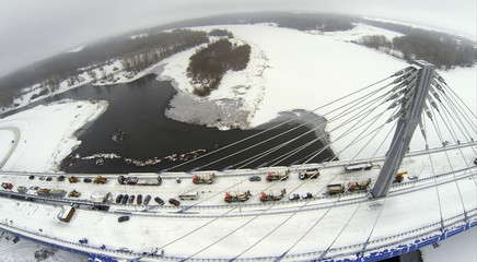Aerial view to construction on Bridge against river