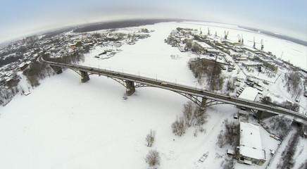 Aerial view to highway bridge over the frozen river