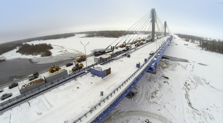 Aerial view to Bridge with construction equipment and cars