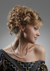 Portrait of a beautiful woman. Natural beauty. Updo.