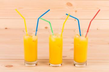 Orange juice on wooden table.