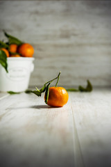 Tangerines on gray wooden background