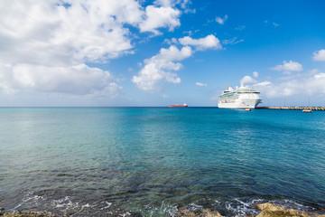 White Cruise Ship Docked Beyond Surf