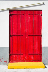 Wood Red Doors Over Yellow Curb
