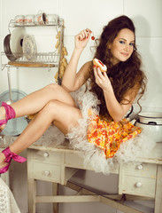 crazy beauty brunette housewife on kitchen cooking