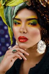 beauty bright woman with creative make up, many shawls on head