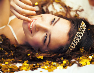 beauty young girl in gold confetti and tiara, little princess