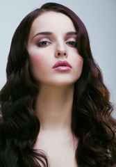 young pretty woman with hairstyle waves, luxury look