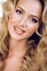 beauty blond woman with long curly hair close up isolated,
