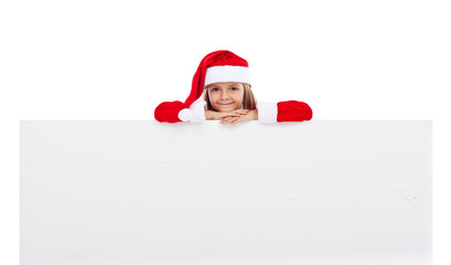 Little santa girl with large banner