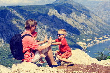 father with kids having fun on vacation in mountains