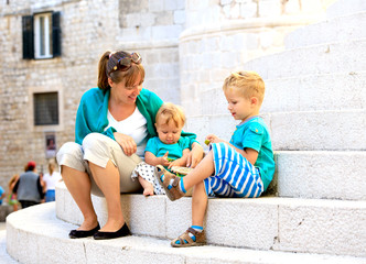 mother with kids on vacation in Europe