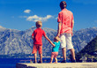 father with kids on vacation in mountains