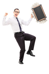 Overjoyed businessman with briefcase full of money