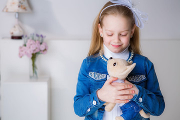 beautiful blond girl with a dog